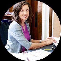 Female teacher working remotely on a desktop computer