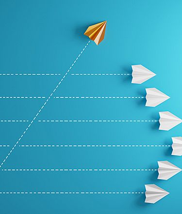 Illustration of an orange paper airplane accelerating ahead of a group of other paper airplanes.